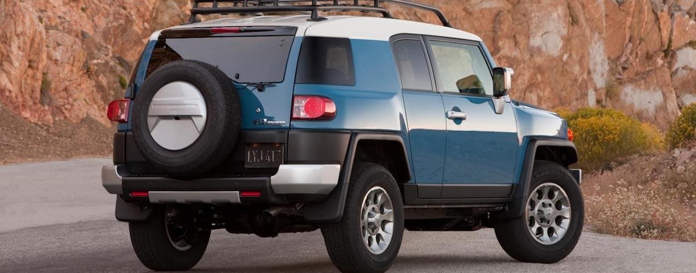 Blue 2014 USed Toyota FJ Cruiser on mountain road