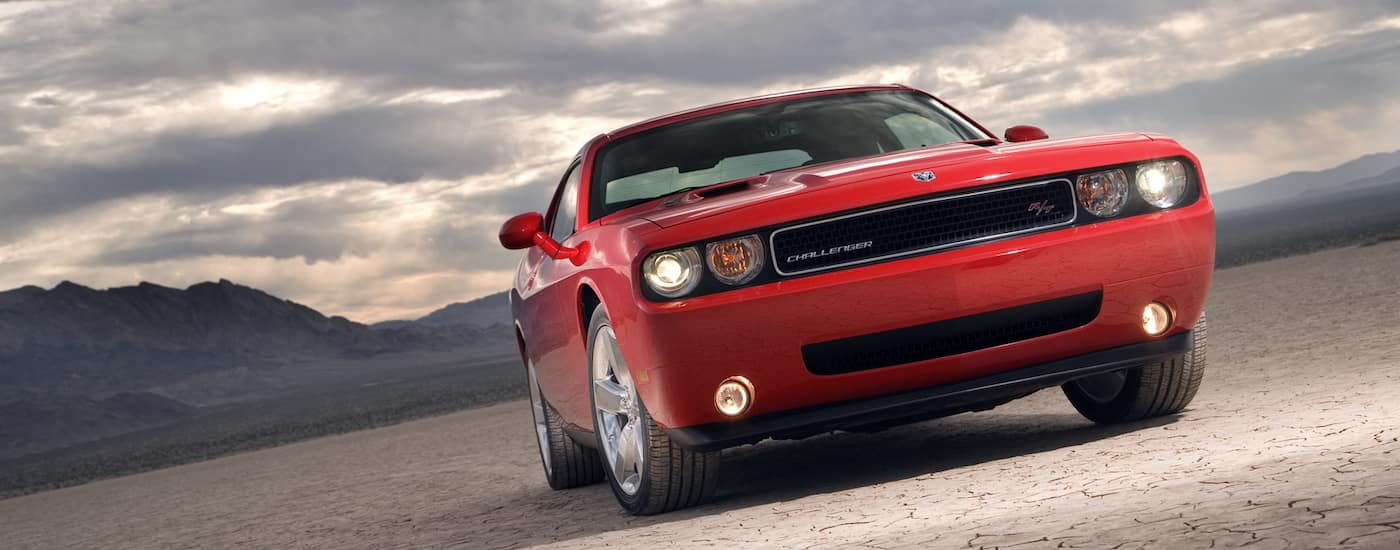Red Used Dodge Challenger Driving in the desert