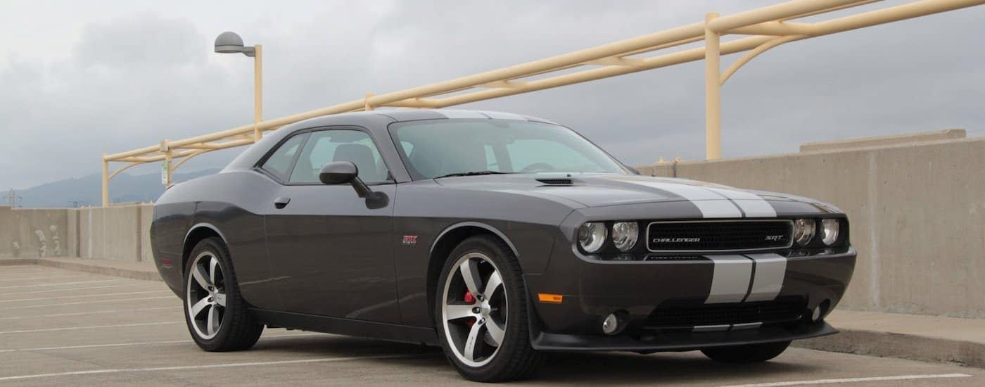 Gray pinstriped Used Dodge Challenger atop a parking garage