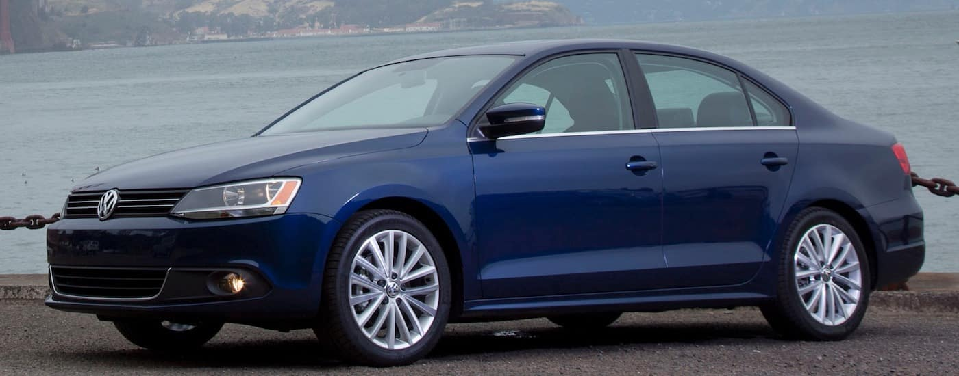 Blue 2011 Used Volkswagen Jetta in front of water