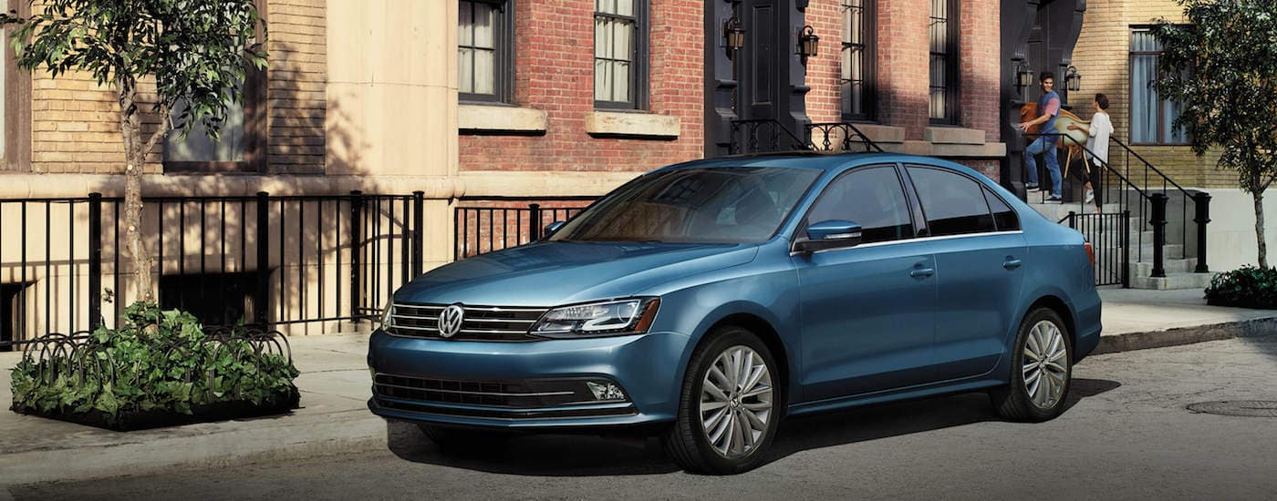 Blue 2016 Used Volkswagen Jetta parked on street street
