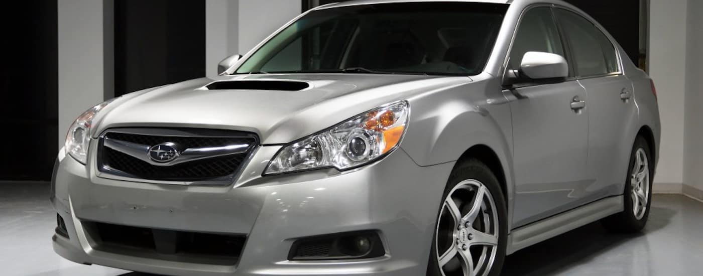 Silver 2011 Used Subaru Legacy parked in a garage