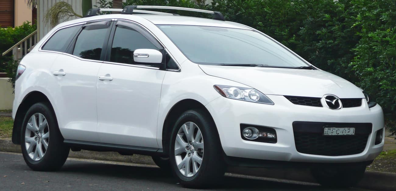 White 2009 used Mazda CX-7 on tree-lined street