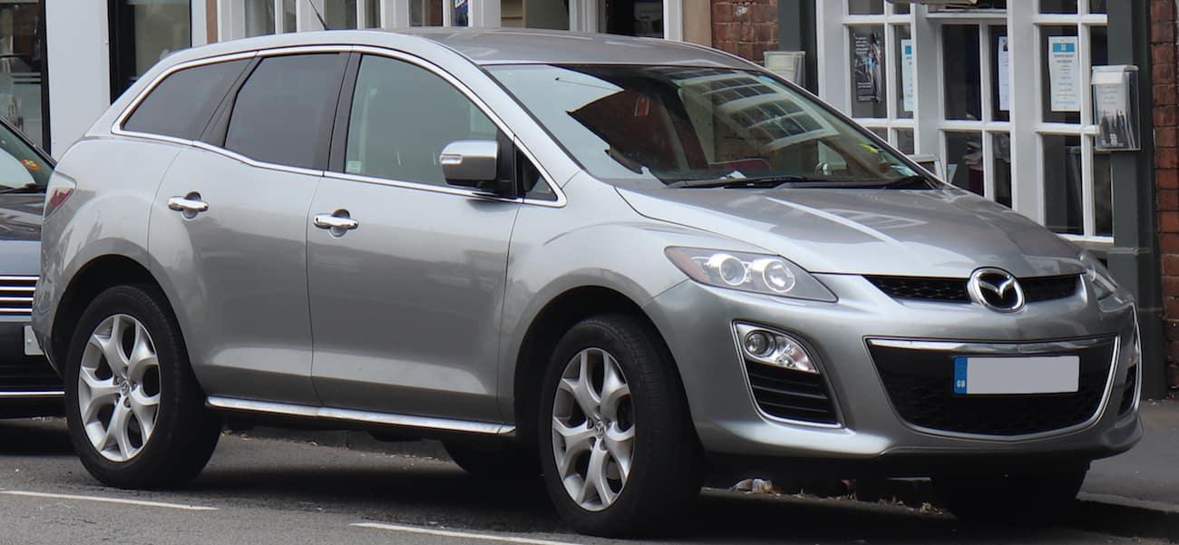 Grey 2011 used Mazda CX-7 on city street
