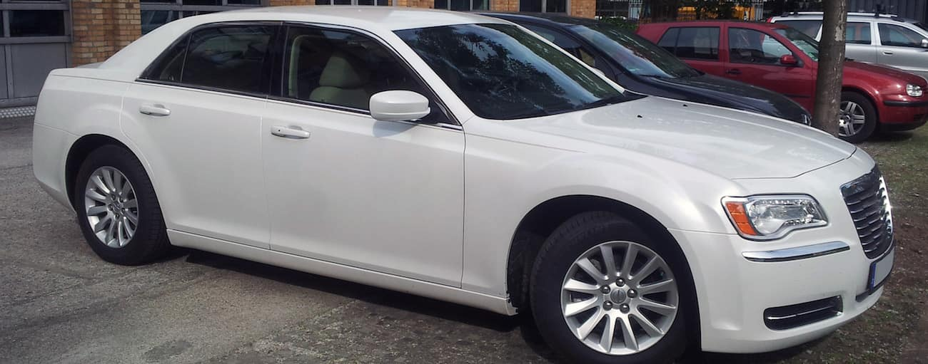 White 2013 used Chrysler 300 in a parking lot