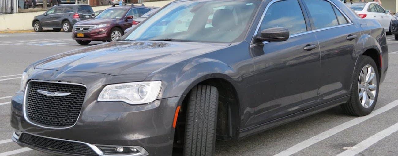 Gunmetal 2015 used Chrysler 300 in a parking garage
