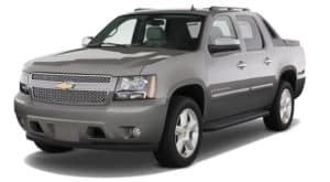 Gray 2009 used Chevy Avalanche on white facing left