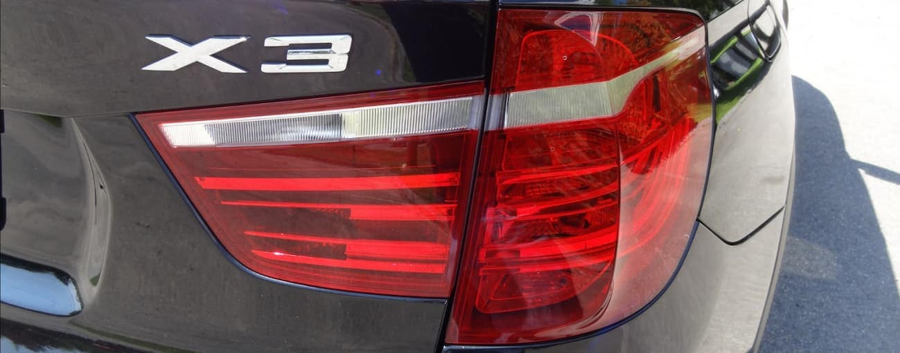 Closeup of the badging and taillight on a black 2014 used BMW X3