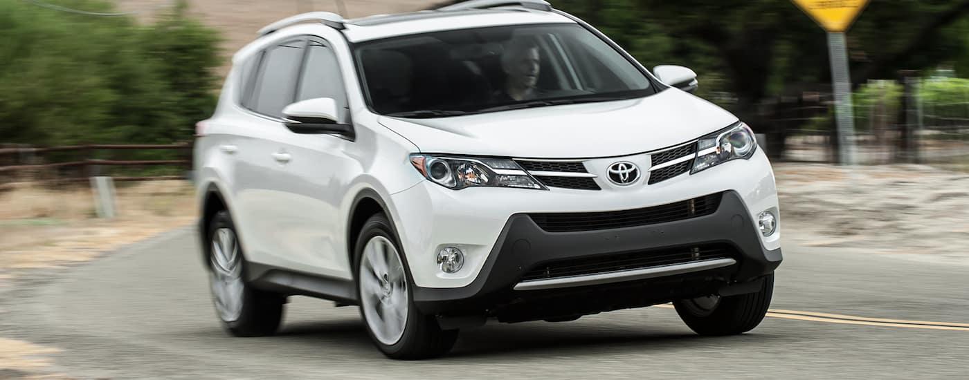 White 2015 Used Toyota RAV4 driving on road
