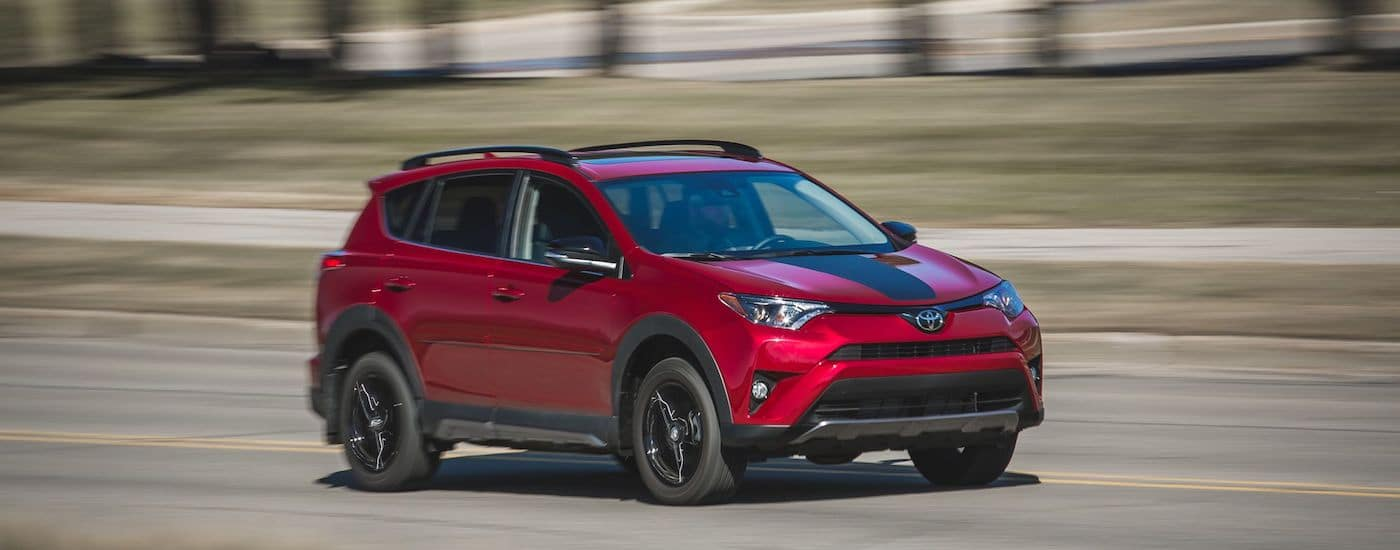 Red 2018 Used Toyota RAV4 driving on highway