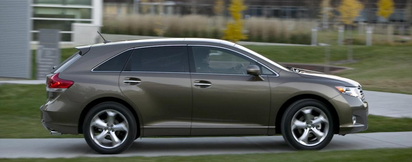 Gray 2009 Used Toyota Venza driving on grassy campus