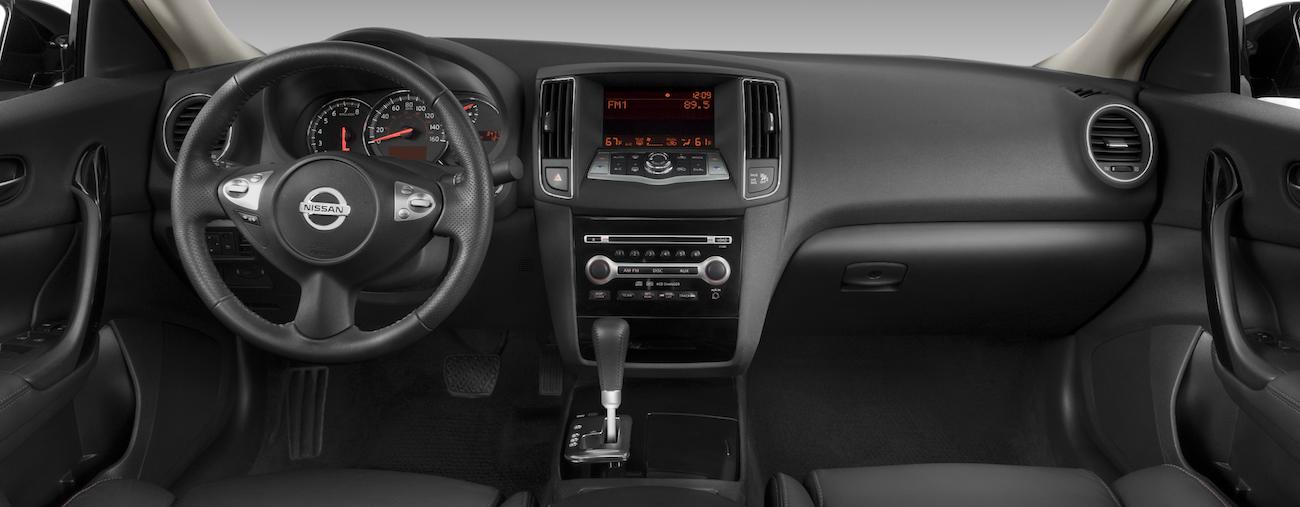 The hi-tech black interior of a 2010 used Nissan Maxima