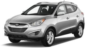 A silver 2010 used Hyundai Tucson on white