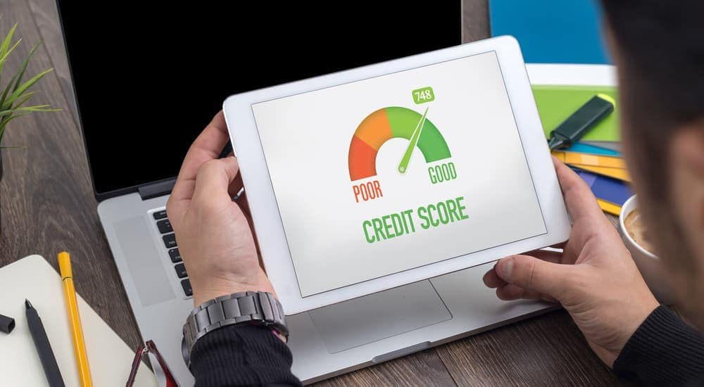 A customer sees improvement in their credit score after paying on time with a buy here pay here loan near Louisville