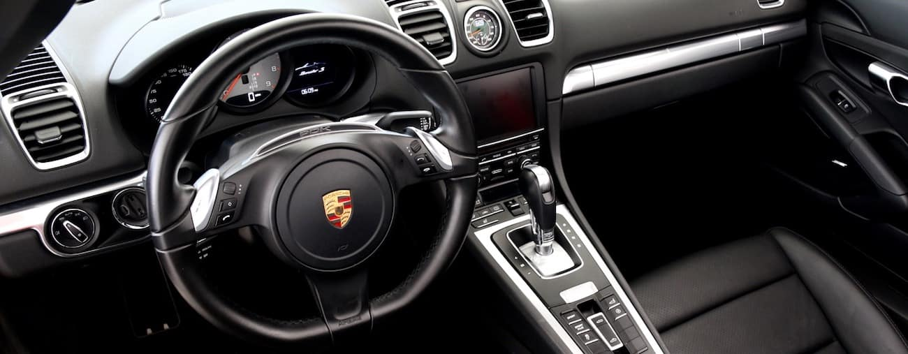 The interior of a 2016 used Porsche Boxter / Cayman in black leather