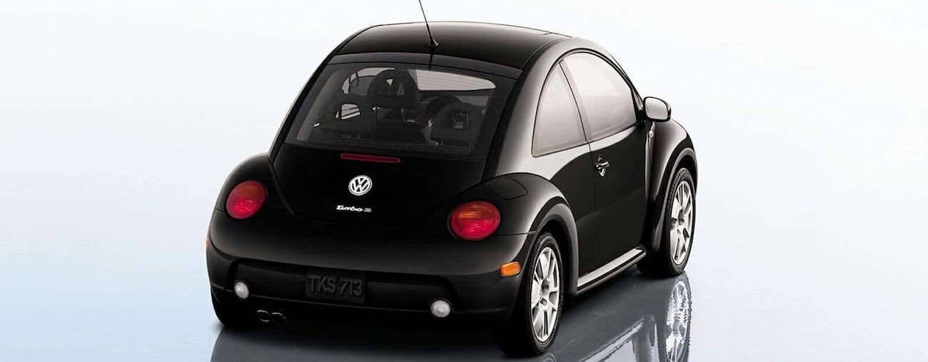 The back of a used black 2002 Volkswagen Beetle from McCluskey Auto