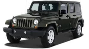 A black 2007 used Jeep Wrangler Unlimited angled left on white