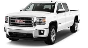 A white 2014 used GMC Sierra facing left on white