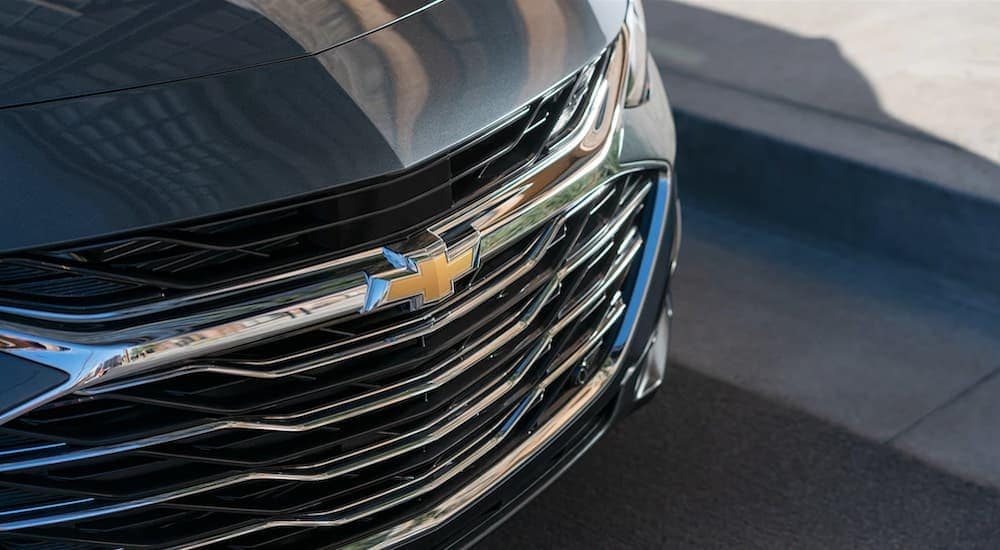 The front of a 2019 Chevy Malibu is featured.