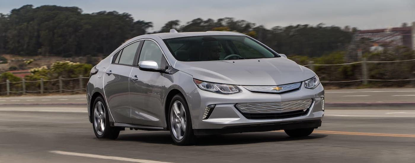 A silver 2017 Chevy Volt is driving through Louisville.