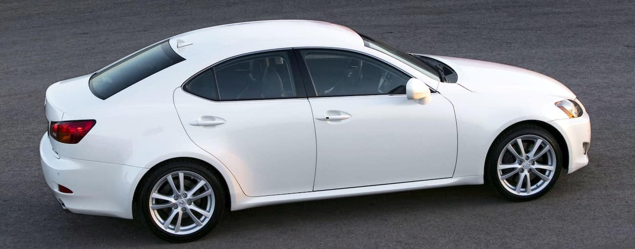 A white 2007 Used Lexus IS is parked on pavement in Cincinnati, OH facing right.