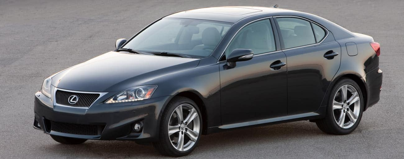 A black 2011 Used Lexus IS is parked on pavement in Cincinnati, OH.