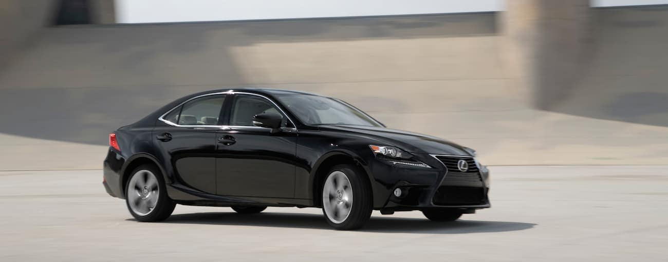 A black 2014 Used Lexus IS is driving out of Cincinnati, OH.