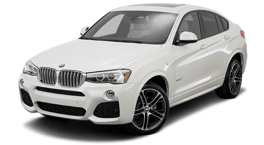 A white 2015 BMW X4 is facing left.