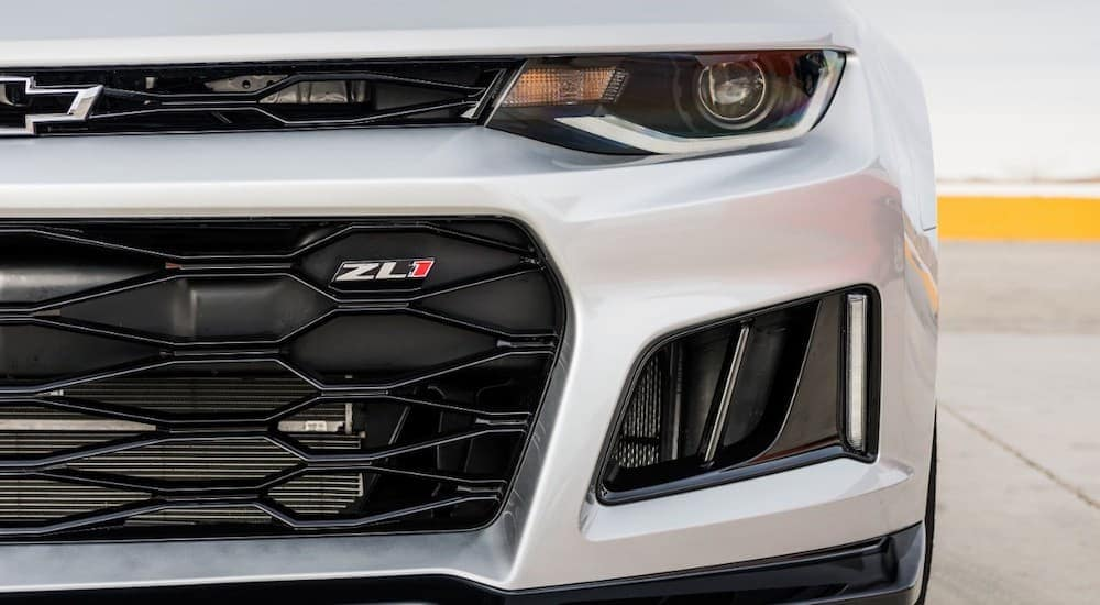 The front of a silver 2017 Chevy Camaro ZL1 is shown in a Cincinnati, OH parking lot because trim levels will change the used car values.