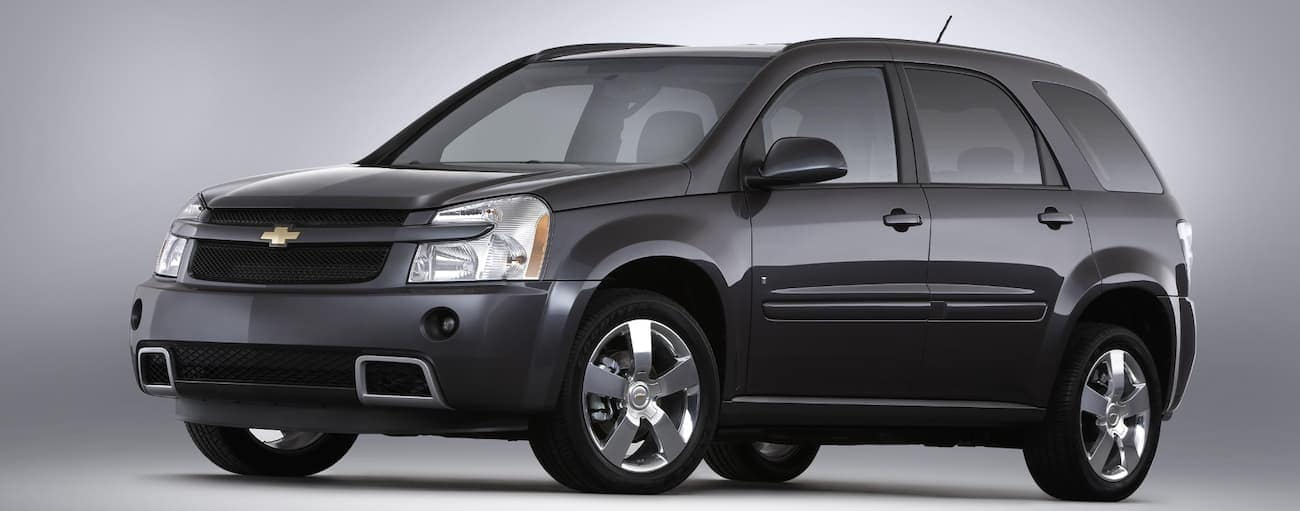 A dark grey 2008 used Chevy Equinox is facing left on a grey background. Check one out a Cincinnati, OH dealership.