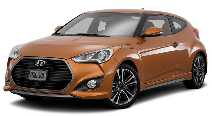 An orange 2015 used Hyundai Veloster is facing left.