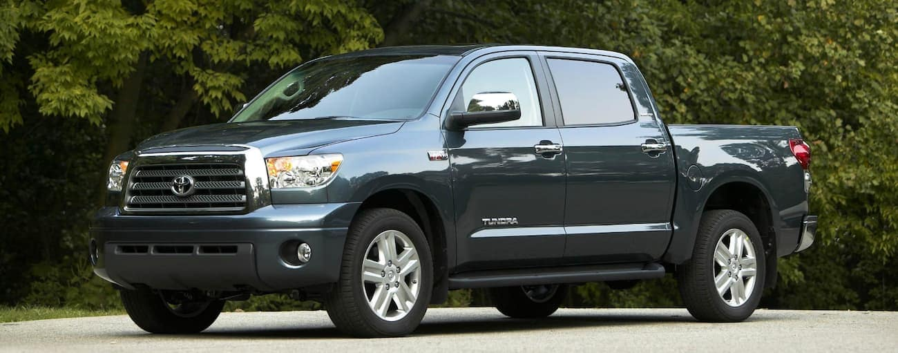 A dark grey used Toyota Tundra is parked in front of trees outside Cincinnati, OH.