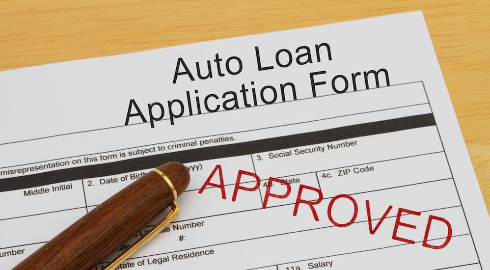 A car loan application is shown at a buy here pay here Louisville dealership.
