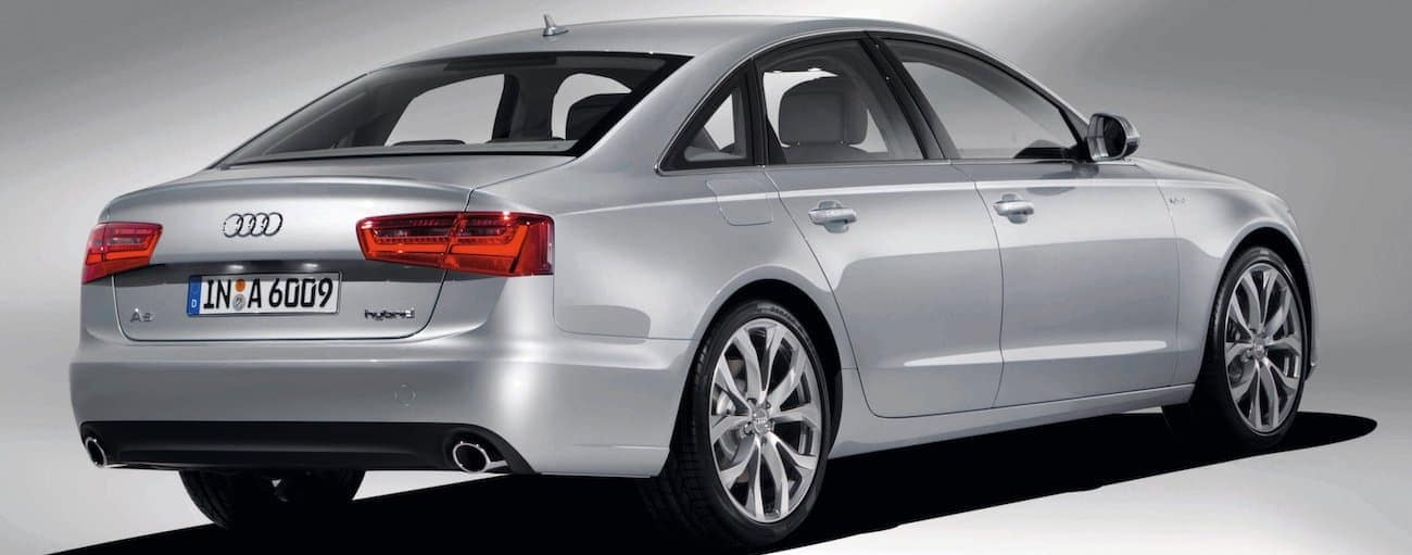 A silver 2012 used Audi A6 is shown on a grey background.