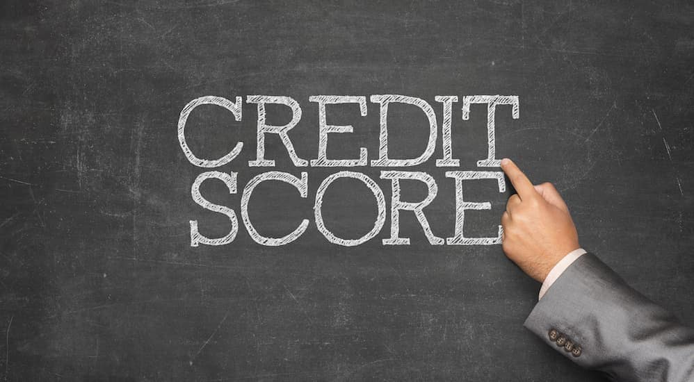 Credit Score is written on a chalkboard