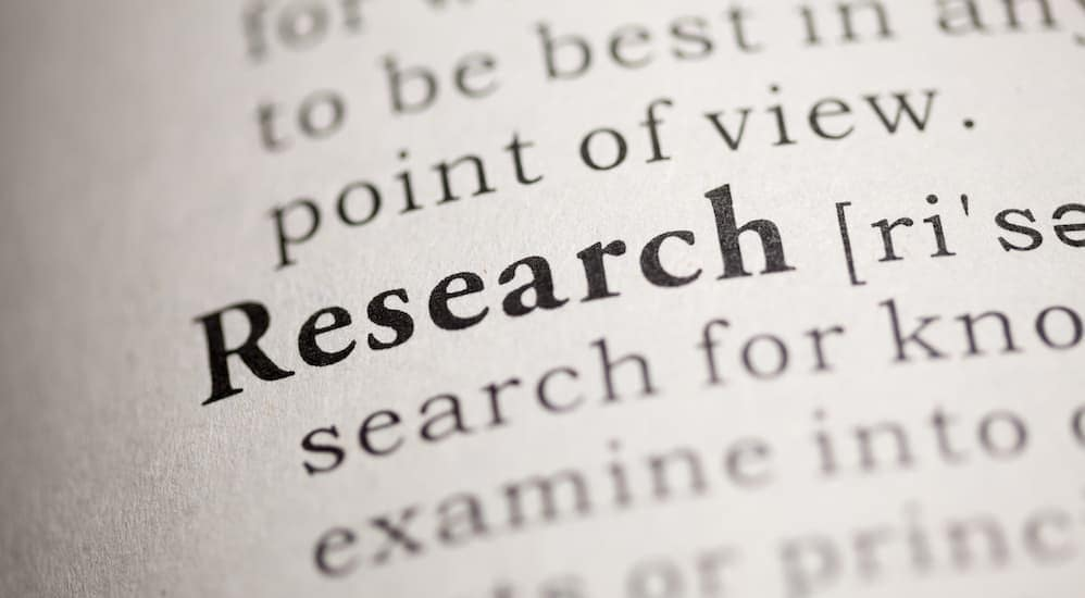 The word Research in the dictionary is in focus.