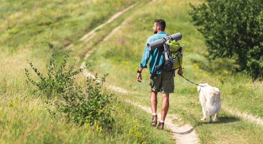 After visiting a Buy Here Pay Here in Lexington - Fall activities were high on this man's list so he took his dog hiking.