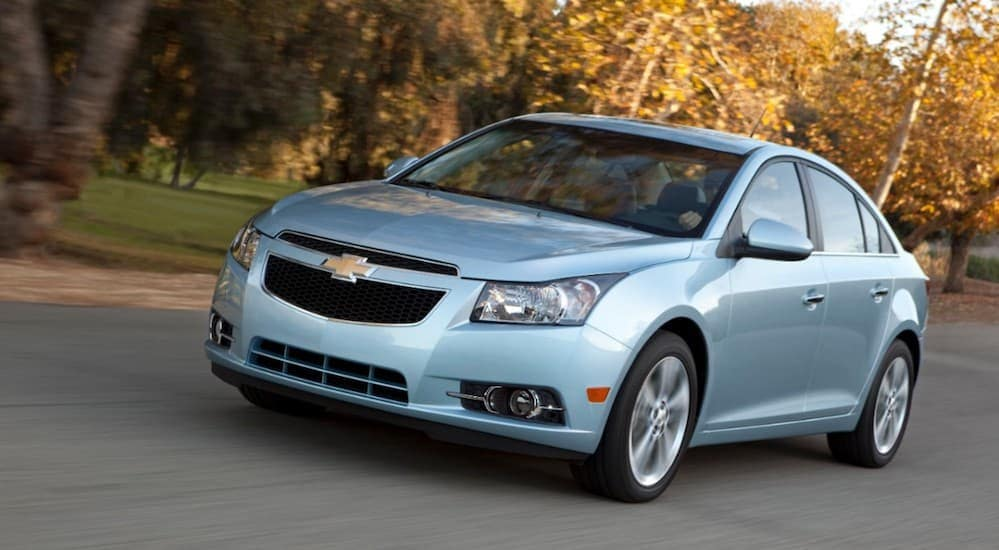 A baby blue 2012 Chevy Cruze is a popular used car that can found at a buy here pay here dealer.