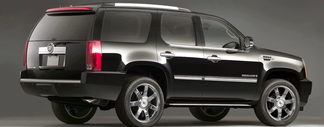A black 2007 Cadillac Escalade is facing right.
