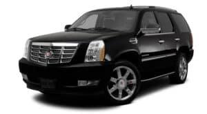 A black 2012 used Cadillac Escalade is facing left.