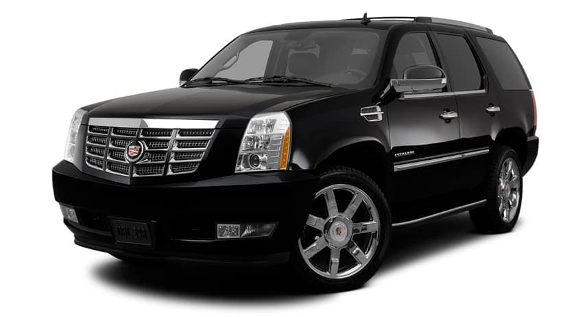 A black 2012 used Cadillac Escalade is facing left.