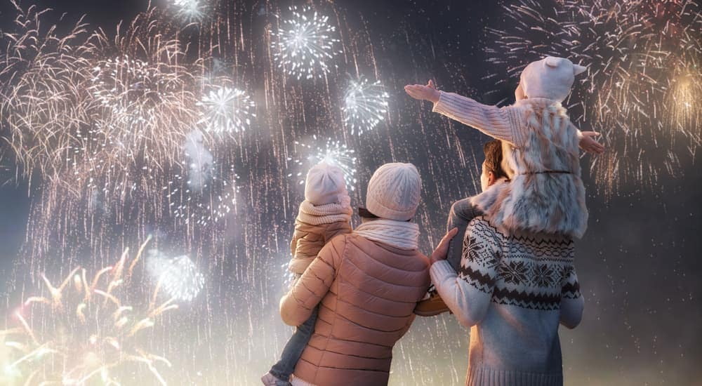 A family is watching fireworks in Cincinnati, OH on New Year's Eve.