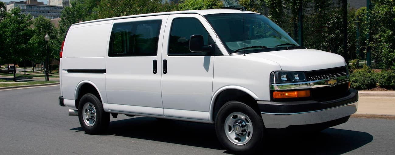 A white 2016 Chevy Express cargo van, which is popular among used Chevy Express 2500 vans in Cincinnati, OH.