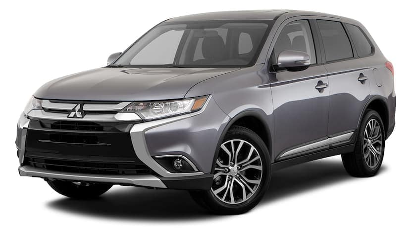 A grey 2018 used Mitsubishi Outlander is facing left.