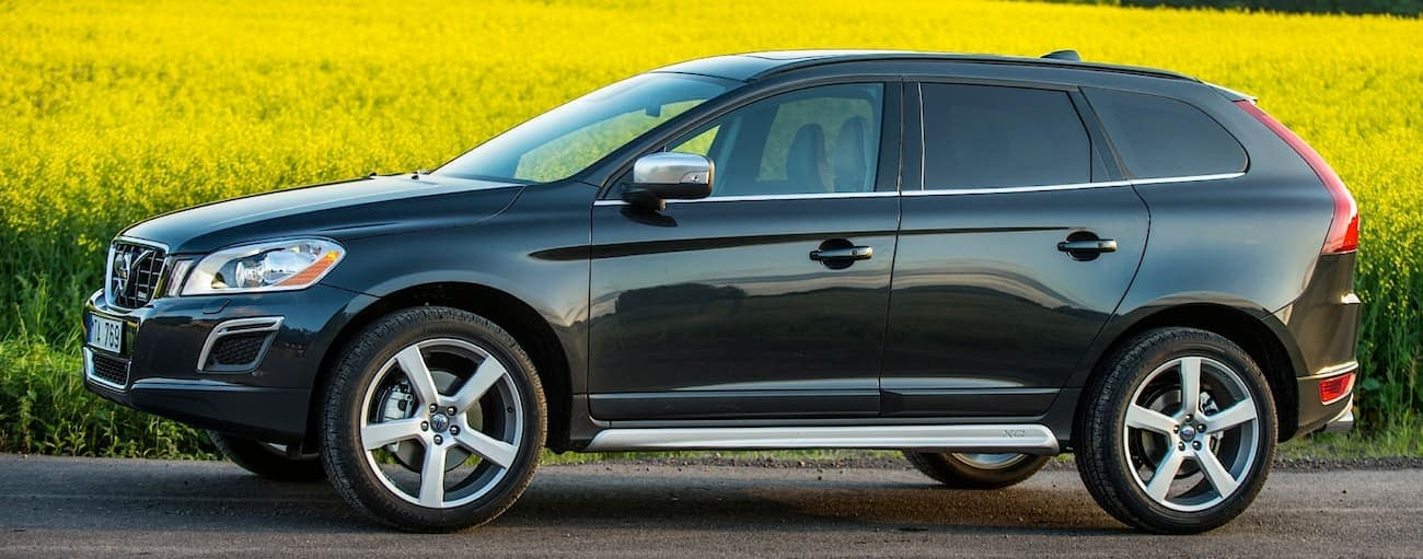 A black 2011 used Volvo XC60 is parked in front of a field outside of Cincinnati, OH.