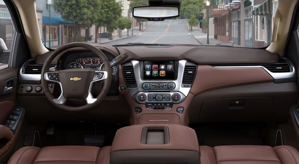 The brown interior of a 2018 Chevy Tahoe is shown.