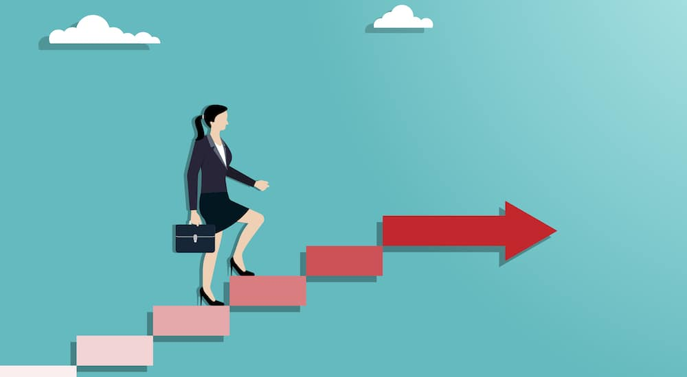 Cartoon image of businesswoman walking up red stairs, into the clouds