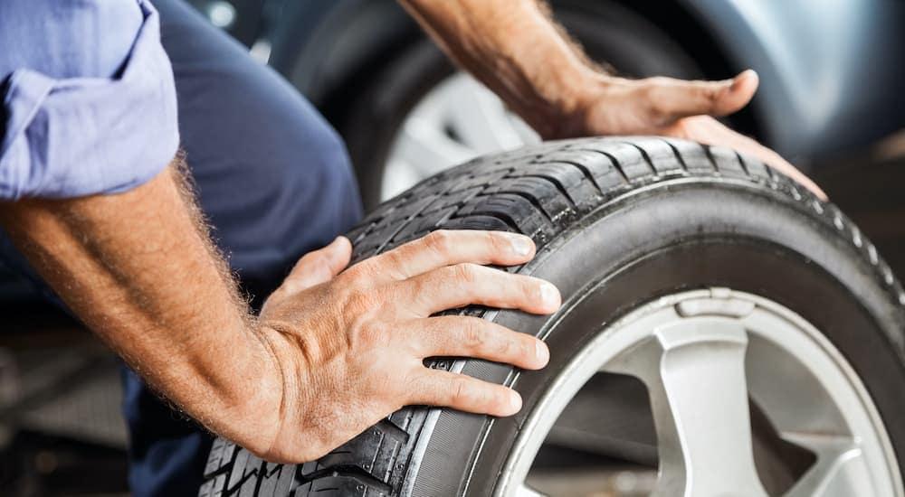 A man is rolling a tire in Cincinnati.