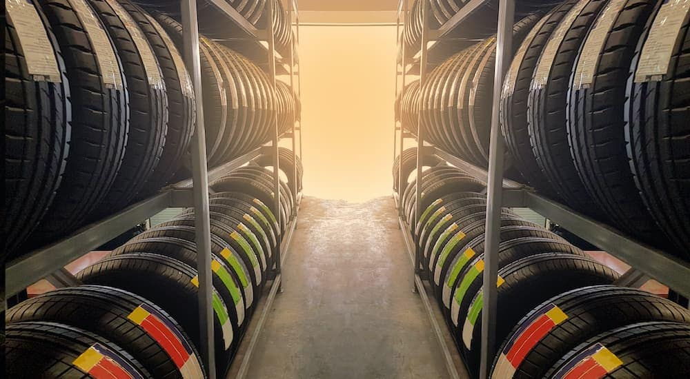 Four rows of tires for sale are shown.