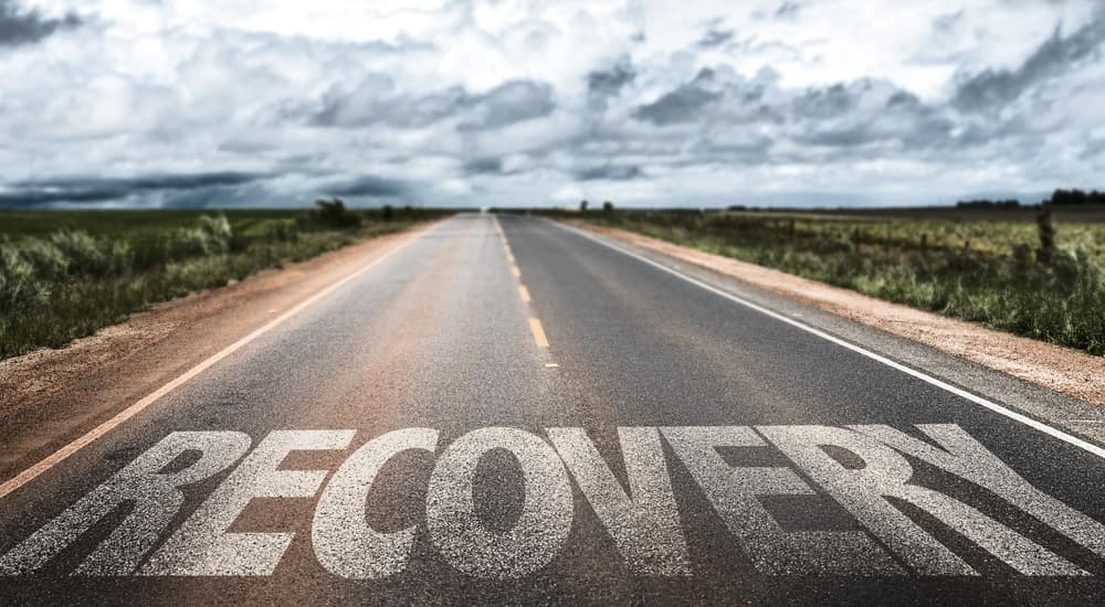 "A long road with ""Recovery"" written on it."